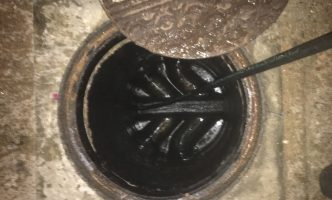 High Pressure Water Jetting of manhole to clear blockage