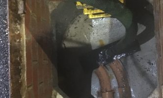 Tanker to manhole to clear waste