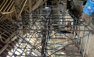scaffold in place to support barn